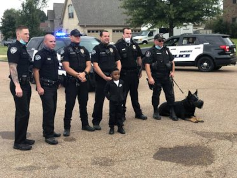 "IN THE PHOTO, Bartlett police officers made a surprise visit to Contract Specialist Sequoria Wilson's son's birthday party, at her request, earlier this month. ""They gave out goody bags to all the kids, took my son on a ride around the block, and took pictures,"" Wilson said. ""The goody bags had masks, a BPD coin, coloring book, candy, toy shields, and more."" (Courtesy photo)"