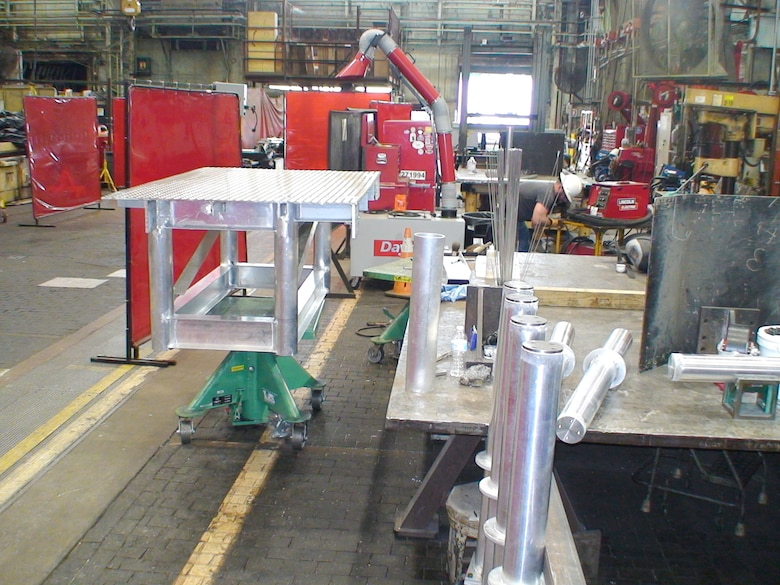 An aluminum platform system, shown here June 22, 2020, prior to having legs installed, is welded by ironworkers with the Arnold Engineering Development Complex (AEDC) Model and Machine Shop as part of a request for the C-2 Engine Test Cell at Arnold Air Force Base, Tenn. (U.S. Air Force photo)