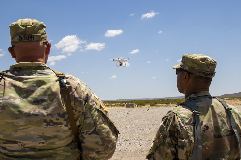 "Soldiers from the 5th Armored Brigade, First Army Division West, test the capabilities of commercial, off-the-shelf unmanned aerial surveillance vehicles at McGregor Range Complex, N.M., in June 2019. To discuss emerging threats posed by small UAS, military and industry leaders in anti-drone technology came together for ""Defending and Defeating,"" a C-sUAS symposium co-hosted by the Force Protection Division, Hanscom Air Force Base, Mass., and the Paul Revere Chapter of the Air Force Association. (U.S. Army Photo by Staff Sgt. Timothy Gray)"