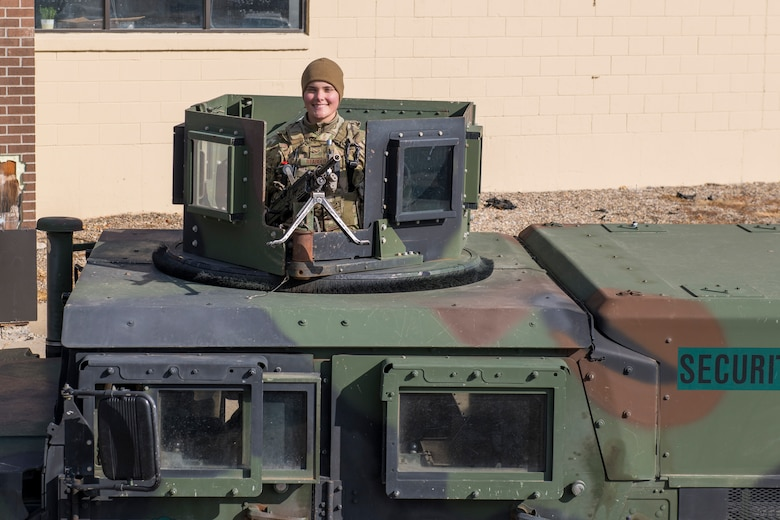 Airman 1st Class Lauryn Reabold, 5th Security Forces Squadron defender, poses for a portrait on Oct. 19, 2020 at Minot Air Force Base, North Dakota. Reabold operates the .240 Echo machine gun out of the Humvee turret on the lead convoy as she and her fellow defenders scout the road and inestigate the avenues of appoach. (U.S. Air Force photo by Airman 1st Class Josh W. Strickland)