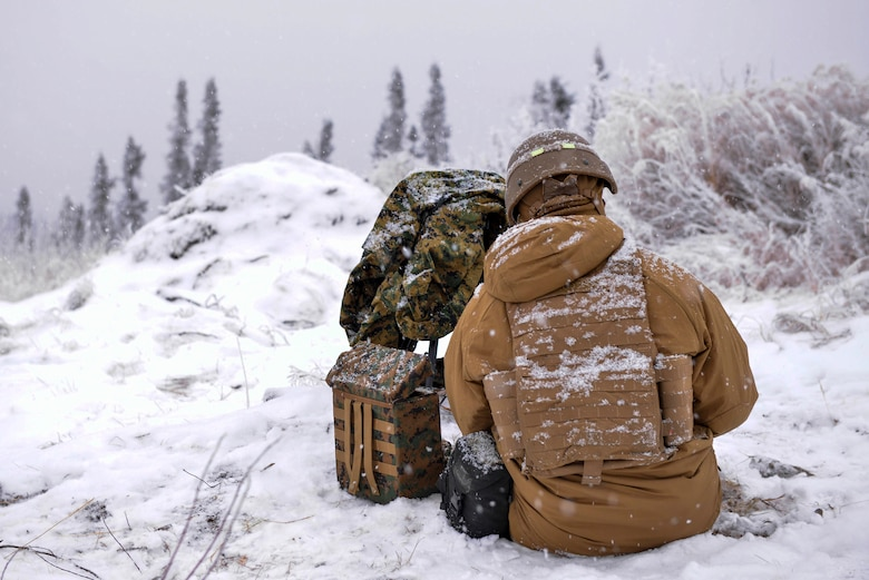 U.S. Marine Corps Lance Cpl. Jarrett Dittenber, a 1st Air Naval Gunfire Liaison Company (ANGLICO) forward observer, sits by his gear during RED FLAG-Alaska 21-1 in the Joint Pacific Alaska Range Complex, Oct. 15, 2020.
