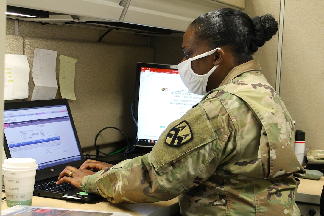 Sgt. First Class Tamarra Ntambi, the schools and individual training non-commissioned officer at the 377th Theater Sustainment Command, processes Soldiers for military schools at the headquarters building in Belle Chasse, La., Oct. 20, 2020.