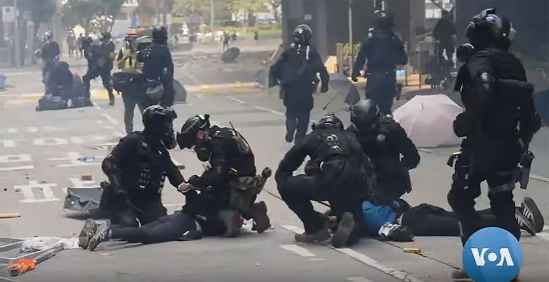 Police seemingly indiscriminately arrested protestors in Hong Kong on riot related charges. (Bill Gallo, VOA News, 18 November 2019)