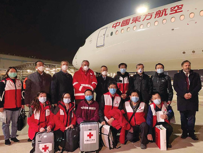 A charter flight carrying a 9-member Chinese aid team and 31 tons of medical supplies arrived in Rome, March 12, 2020.
