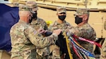 "Lt. Col. Rodney Seaba, left, commander of the Kansas Army National Guard's 2nd Combined Arms Battalion, 137th Infantry Regiment, and Command Sgt. Maj. Paul Purdham, right, case the regimental colors of the Kansas Army National Guard's 2nd CAB, 137th Infantry Regiment Oct. 17. The ceremony was held to redesignate the 2nd CAB, 137th Infantry Regiment, ""First Kansas,"" as the 1st Battalion, 635th Armor Regiment, in accordance with a 2012 Army chief of staff directive."
