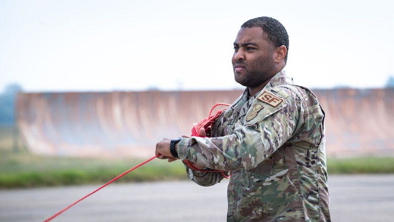 Staff Sgt. Dijon Moore, 2nd Security Forces Squadron vehicle control officer, winds rope while setting up for Global Thunder 21 at Barksdale Air Force Base, La., Oct. 20, 2020.