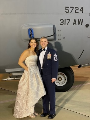 Julie Umfleet, left, and Chief Master Sgt. Mark Umfleet, 317th Airlift Wing command chief, pose for a photo at the Air Force Ball at Dyess Air Force Base, Texas, Oct. 7, 2020. The Umfleets posed infront of a static C-130J Super Hercules. (U.S. Air Force courtesy photo)