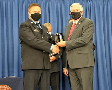 Sgt. Joshua Roth receives the Governor's Medal from the 57th Governor of Missouri, Mike Parson.