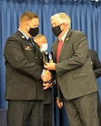 Sgt. Joshua Roth receives the Governor's Medal from the 57th Governor of Missouri, Mike Parson. Roth, a sergeant in the Missouri National Guard, received the award for actions he took to save the life of a small child while on duty as a firefighter and Emergency Medical Technician in August of 2019.