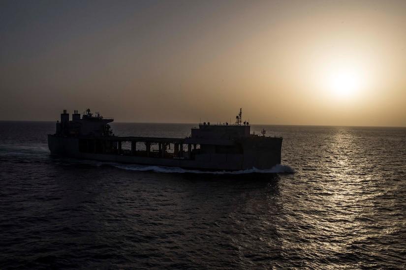 A ship transits the sea.