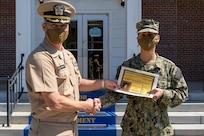PENSACOLA, Fla. (Oct. 2, 2020) Cmdr. Zach McKeehan (left), Information Warfare Training Command (IWTC) Corry Station commanding officer, presents Cryptologic Technician (Collection) Seaman Apprentice Daniel M. Vega with the Gold Samuel B. Morse Award onboard Naval Air Station Pensacola Corry Station. Vega is the first student in recent history from the revised Basic Manual Morse Trainer course awarded the Gold Samuel B. Morse Award. (U.S. Navy photo by Senior Chief Cryptologic Technician Collection Raymond M. Donato)
