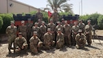 The Wisconsin Army National Guard's 924th Engineer Detachment is deployed to Camp Arifjan, Kuwait, functioning as the department of public works for the large base.