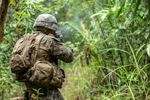 A U.S. Marine with Lima Company, Battalion Landing Team 3/5, 11th Marine Expeditionary Unit, fires an M4A1 Carbine during a live-fire event in Malaysia. Malaysian Armed Forces were joined by U.S. Marines and Sailors for exercise Tiger Strike 2019 where both forces participated in jungle survival, amphibious assault, aerial raids, and combat service support training and cultural exchanges (U.S. Marine Corps photo by Cpl. Dalton S. Swanbeck)