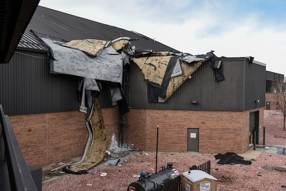 The entire roof of a hangar next to the flightline at Peterson Air Force Base, Colorado, is lifted off the structure during a wind storm Jan. 9, 2017.