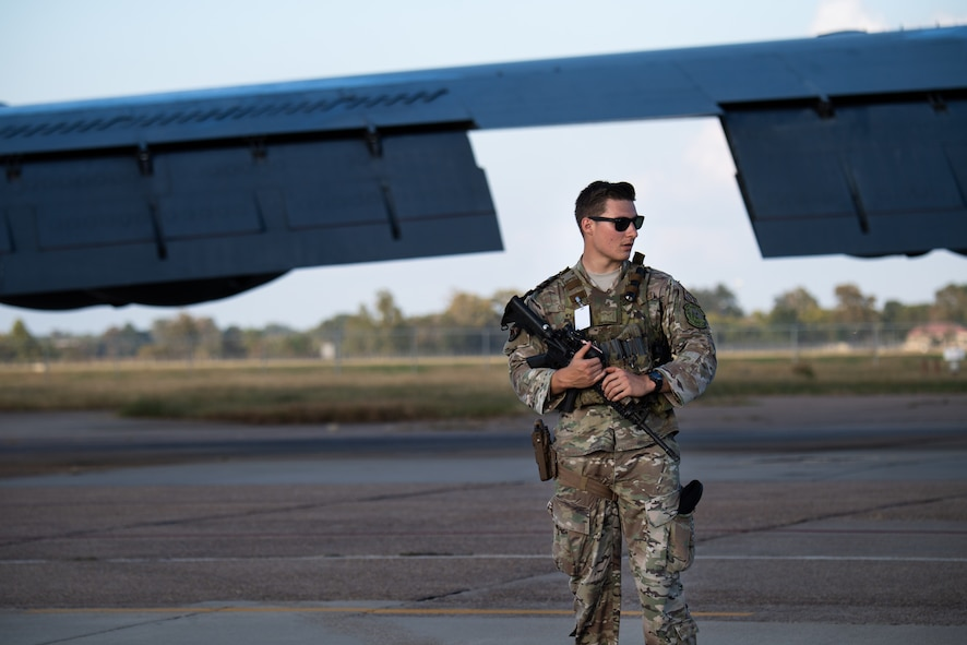Airman 1st Class Jacob Oldfield, 2nd Security Forces Squadron entry controller, stands guard at an entry control point during Global Thunder 21 at Barksdale Air Force Base, La., Oct. 20, 2020. Exercises like GLOBAL THUNDER involve extensive planning and coordination to provide unique training opportunities for assigned units and forces. (U.S. Air Force photo by Airman 1st Class Jacob B. Wrightsman)