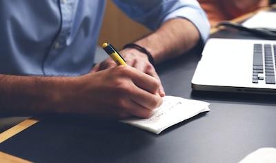 Man writing on notepad