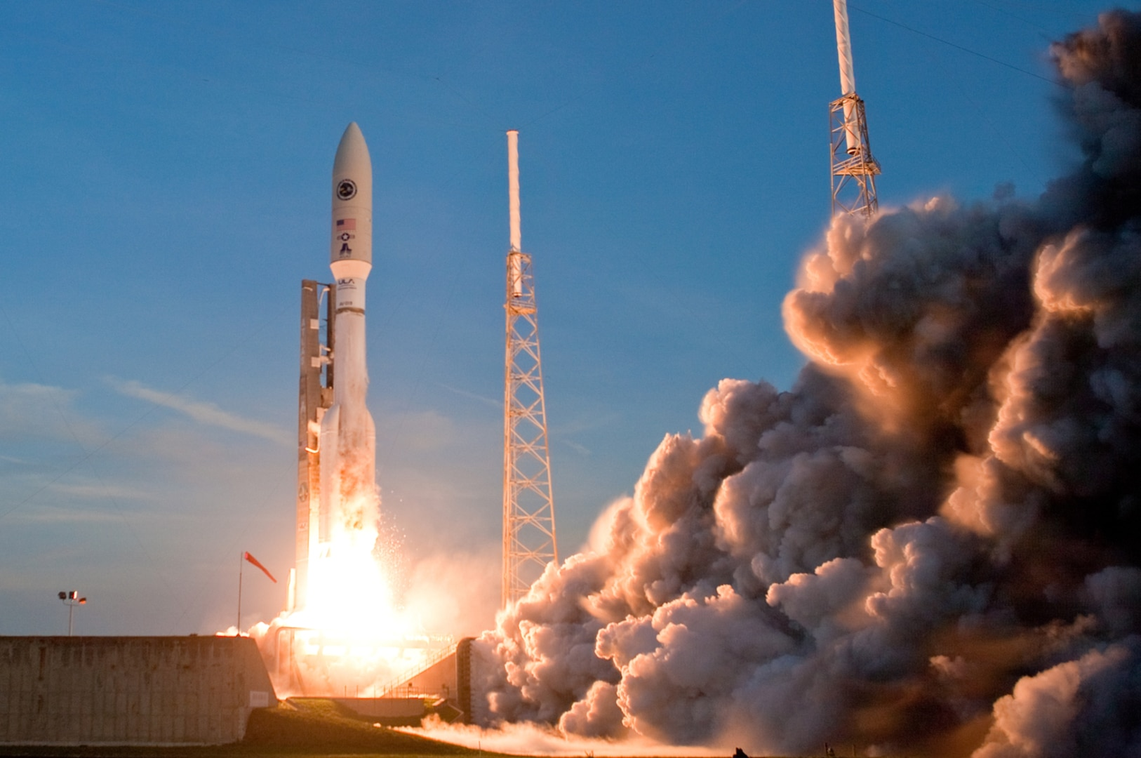 A rocket lifts off from a launch pad