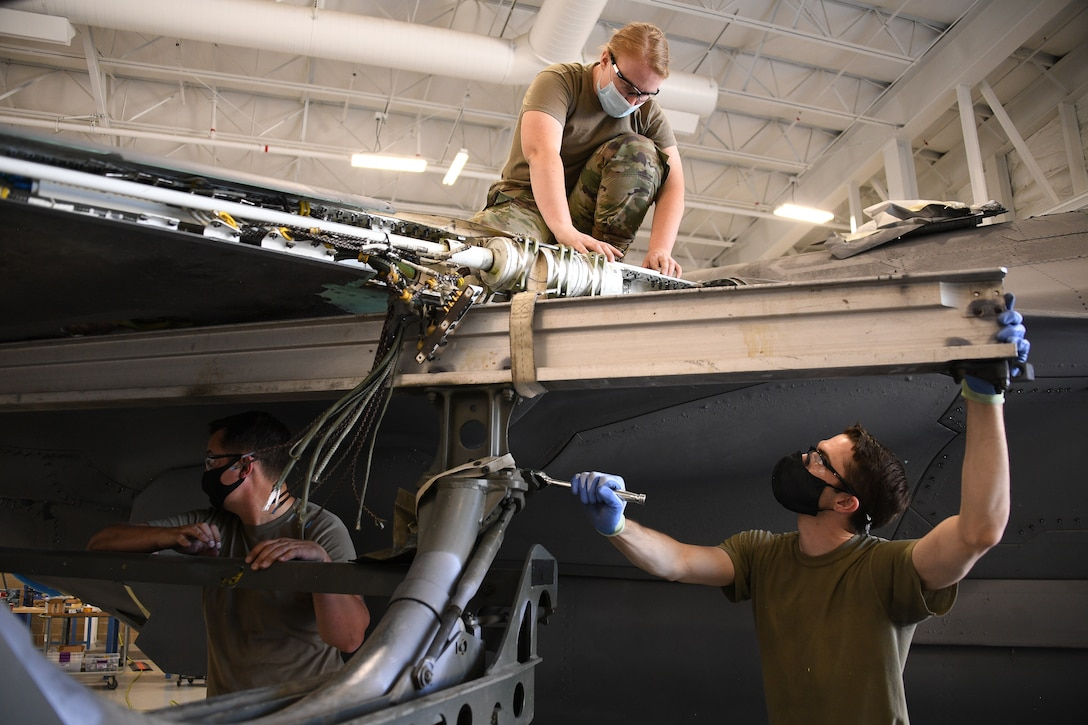 Staff Sgt. Samantha Birnshein and Tech. Sgt. Emil Wodicka, 372nd Training Squadron Detachment 3, work a wing reattachment and repair on a repurposed F-35A Lightning II.