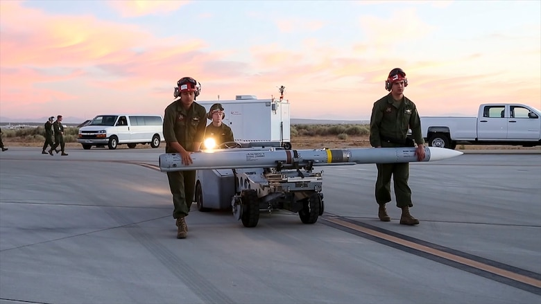 Ground crews prepare an AIM-120 missile for a flight test at Edwards Air Force Base, California, July 10. (Photo courtesy of Lance Cpl. Larisa Chavez, MCAS Yuma)