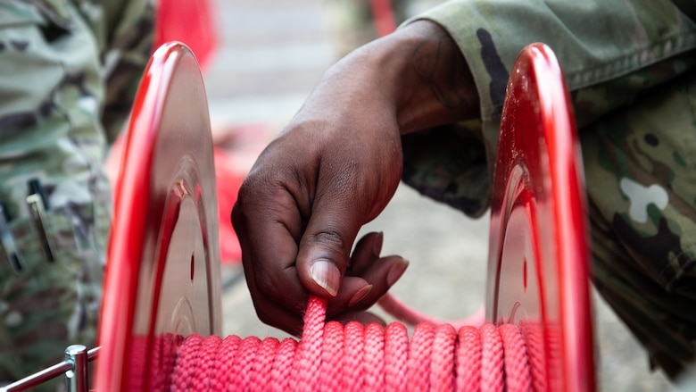 Staff Sgt. Jalen Allen, 2nd Security Forces Squadron supply NCO in-charge, prepares rope while setting up for Global Thunder 21 at Barksdale Air Force Base, La., Oct. 20, 2020.