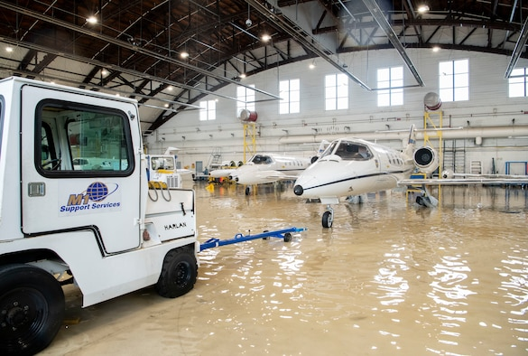 A towing truck operator gets ready to move a C-21 Lear Jet from a hangar at Scott Air Force Base, Illinois, Aug. 12, 2020.