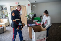 A U.S. Marine delivers donation boxes to the Guam Chamber of Commerce to commence the 2020 Toys for Tots Campaign on Oct. 14.