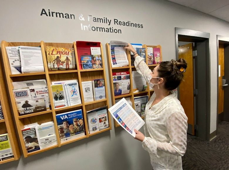 Photo of person placing papers in organizational display