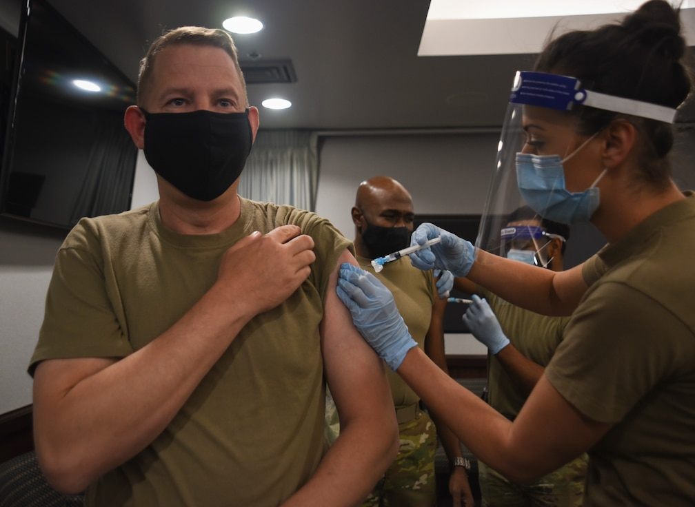 Commander getting flu shot.