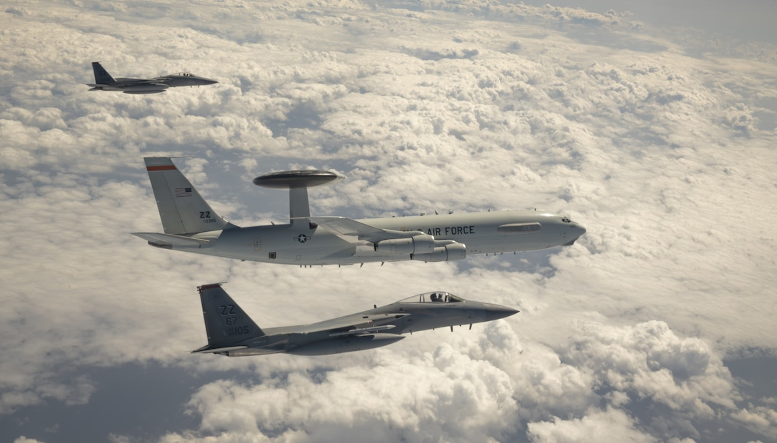 U.S. Air Force F-15C Eagles and an E-3 Sentry aircraft assigned to the 18th Wing fly in formation after participating in Exercise Westpac Rumrunner, out of Kadena Air Base, Japan, Oct. 16, 2020. Taking steps to innovate and integrate during exercises and operations enhances readiness and lethality for the 18th Wing, its allies and partners so the wing is ready to respond quickly. The various efforts undertaken to promote the PACAF mission directly contribute to the ability to strengthen alliances and partnerships with an emphasis on interoperability, domain awareness, information sharing, and disaster response. (U.S. Air Force photo by Tech. Sgt. Daniel E. Fernandez)