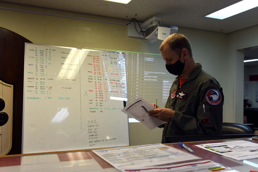 """Lt. Col. Craig Van Beusekom, commander of the 67th Fighter Squadron, conducts command-and-control operations while communicating with pilots from the 67th FS during Exercise WestPac Rumrunner at Kadena Air Base, Japan, Oct. 16, 2020. """"Rumrunner 3.0 was an awesome, high-end training opportunity for the F-15 pilots of the 44th and 67th Fighter Squadrons at Kadena,"""" Van Beusekom said. """"The overall mission was remarkable--we launched 45 U.S. Air Force, U.S. Navy, and U.S. Marine Corps aircraft of 11 types from five locations."""" (U.S. Air Force photo by Staff Sgt. Kristan Campbell)"""