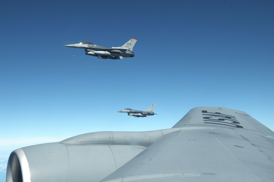 Two U.S. Air Force F-16 Fighting Falcons fly beside a KC-135 Stratotanker from the 909th Air Refueling Squadron, waiting to be refueled during Exercise WestPac Rumrunner, Oct. 16, 2020, out of Kadena Air Base, Japan. The National Defense Strategy directs the armed forces to be more lethal, enhance relationships with allies and partners, and encourage institutional reform. The 18th Wing is employing this directive by developing and continuing new training exercises like WestPac Rumrunner. This exercise represents an evolution in training to adapt to the environment of great power competition. (U.S. Air Force photo by Airman 1st Class Rebeckah Medeiros)
