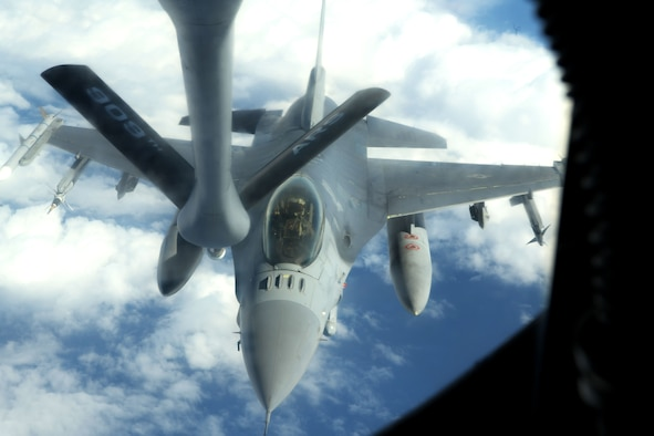 U.S. Air Force F-16 Fighting Falcon from the 35th Fighter Wing, Misawa Air Base, Japan, prepares to be refueled by a KC-135 Stratotanker from Kadena Air Base, Japan, during the third iteration of Exercise WestPac Rumrunner, Oct. 16, 2020. WestPac Rumrunner enables units and assets currently stationed or on Temporary Duty in the Western Pacific area of responsibility to train together without the typical demands of a TDY. The exercise incorporated over 45 aircraft from across the services including the U.S. Air Force, U.S. Navy, and U.S. Marine Corps. (U.S. Air Force photo by Airman 1st Class Rebeckah Medeiros)