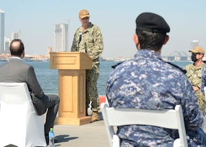 MANAMA, Bahrain (Oct. 21, 2020) Rear Adm. Curt Renshaw, deputy commander, U.S. Naval Forces Central Command, speaks during a ribbon cutting ceremony celebrating the installation of the coalition maritime forces waterfront security barrier at the Mina Salman Pier on board NSA Bahrain. The barrier is the first water-limited obstacle system security barrier system ever installed at an overseas naval installation, and the longest waterside security barrier in the U.S. Navy. NSA Bahrain enables the forward operations and responsiveness of U.S. and allied forces in support of Navy Region Europe, Africa, Central's mission to provide services to the fleet, warfighter and family. (U.S. Navy photo by Mass Communication Specialist 1st Class Justin Yarborough)
