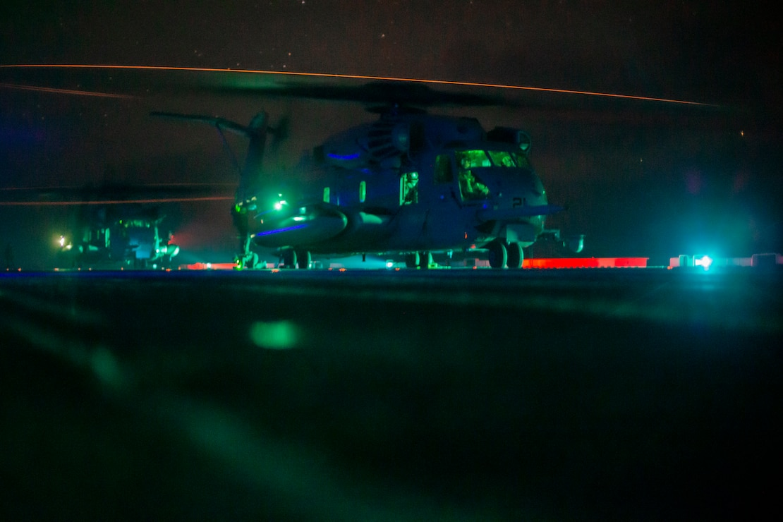 U.S. Marines in a CH-53E Super Stallion prepare for takeoff from the amphibious assault ship USS Makin Island (LHD 8), Oct. 18.