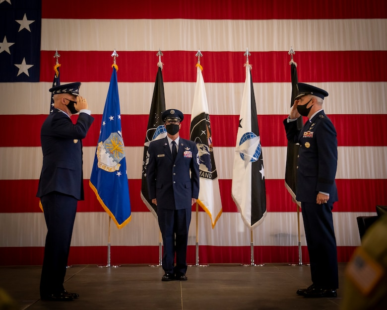 """Gen. John W. """"Jay"""" Raymond, U.S. Space Force Chief of Space Operations, receives a salute from Lt. Gen. Stephen N. Whiting, first commander of the newly re-designated Space Operations Command, during the activation ceremony at Peterson Air Force Base, Colo., Oct 21, 2020."""