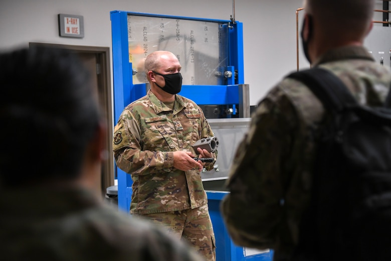 Staff Sgt. Robert Thorell, 22nd Maintenance Squadron nondestructive inspections dayshift lead, briefs Airmen about the NDI impact on Team McConnell's mission readiness Oct. 14, 2020, at McConnell Air Force Base, Kansas. The course aimed to elevate the participants from a tactical level of thinking to an operational and strategic perspective that is necessary for scope of influence a squadron superintendent possesses. (U.S. Air Force photo by Airman 1st Class Nilsa Garcia)