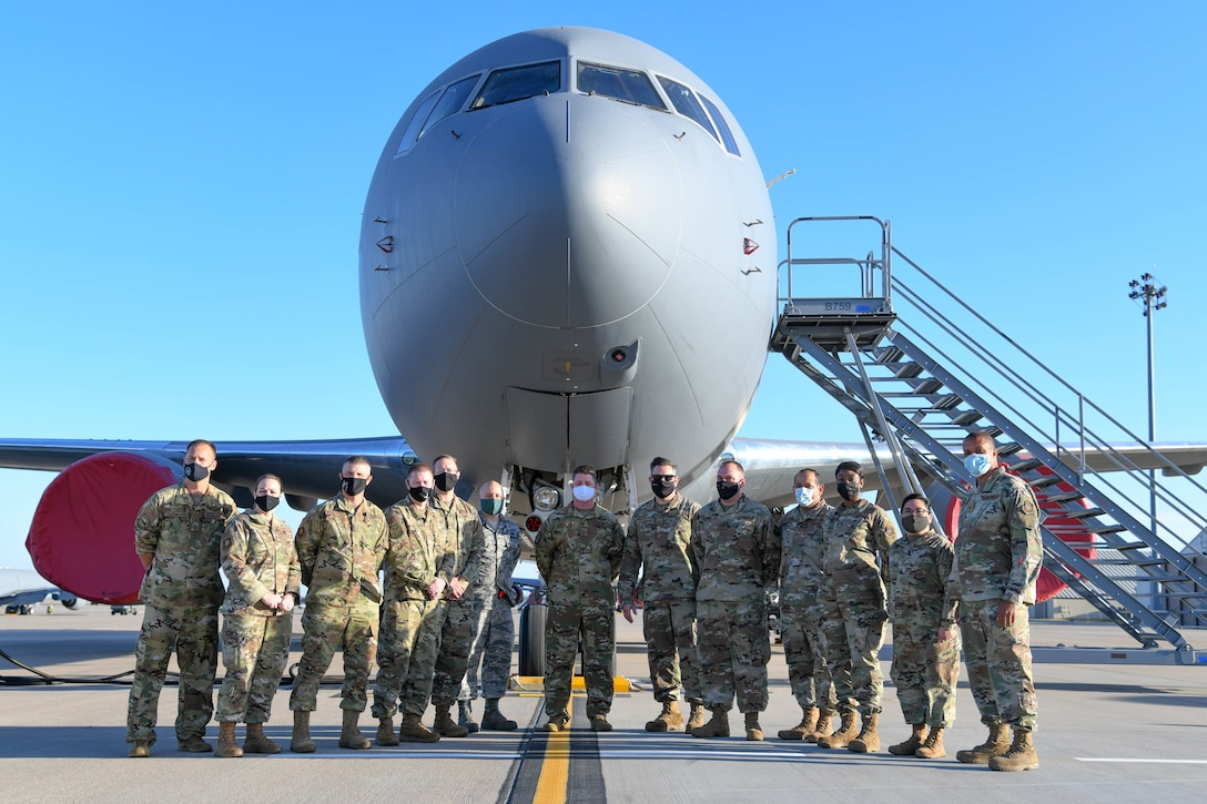 Airmen participating in the Wing Squadron Superintendent Course pose for a photo in front of a KC-46 Pegasus Oct. 14, 2020, at McConnell Air Force Base, Kansas. The purpose of the course is to provide tools to develop solution-minded, operational and strategic-level thinking squadron superintendents required in today's and tomorrow's Air Force.  (U.S. Air Force photo by Airman 1st Class Nilsa Garcia)