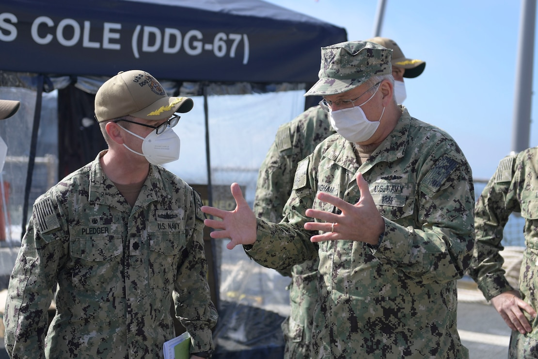 Rear Adm. Bruce Gillingham, right, the surgeon general of the Navy, speaks with Cmdr. Edward Pledger, commanding officer of USS Cole (DDG 67) during a visit aboard the ship.