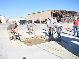 The Air Force Civil Engineer Center Lab research team perform the dry placement of K-Fill CLSM