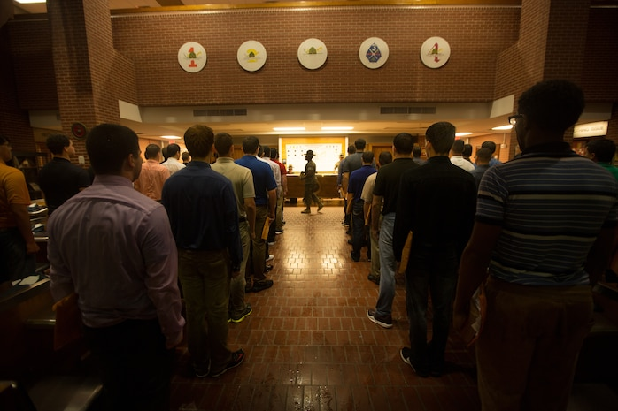 A drill instructor with Recruit Processing Company, Support Battalion, gives new recruits of Echo Company, 2nd Recruit Training Battalion, one of their first orders on Parris Island, S.C., May 22, 2017. Recruits must go through processing to ensure they have the necessary uniforms and equipment to begin training. Echo Company is scheduled to graduate Aug. 18, 2017. Parris Island has been the site of Marine Corps recruit training since Nov. 1, 1915. Today, approximately 19,000 recruits come to Parris Island annually for the chance to become United States Marines by enduring 12 weeks of rigorous, transformative training. Parris Island is home to entry-level enlisted training for approximately 49 perceA U.S. Marine Corps drill instructor with Recruit Processing Company, Support Battalion, gives new recruits of Echo Company, 2nd Recruit Training Battalion, one of their first orders on Parris Island, S.C., May 22, 2017. Recruits must go through processing to ensure they have the necessary uniforms and equipment to begin training. Echo Company is scheduled to graduate Aug. 18, 2017. Parris Island has been the site of Marine Corps recruit training since Nov. 1, 1915. Today, approximately 19,000 recruits come to Parris Island annually for the chance to become United States Marines by enduring 12 weeks of rigorous, transformative training. Parris Island is home to entry-level enlisted training for approximately 49 percent of male recruits and 100 percent of female recruits in the Marine Corps. (U.S. Marine Corps photo by Lance Cpl. Carlin Warren)nt of male recruits and 100 percent of female recruits in the Marine Corps. (Photo by Lance Cpl. Carlin Warren)