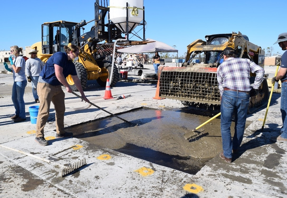 The Air Force Civil Engineer Center's Readiness Directorate research team fills craters using K-Concrete.