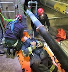 U.S. Army Garrison Alaska, Fort Greely Firefighters Colin Winkelman, left, and Mark Zastavskiy respond to a confined space rescue response scenario during a three week, agency mandated, training course provided by the Maryland Fire and Rescue Institute at the University of Maryland.