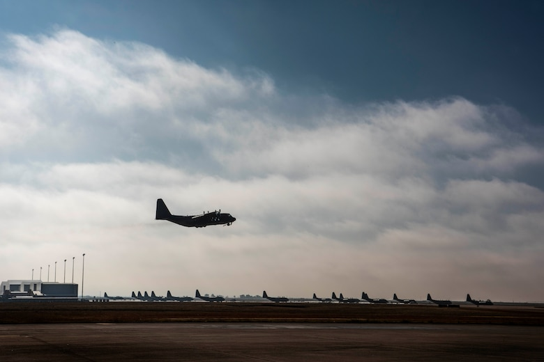 An AC-130W Stinger II gunship, Tail No. 1303, flies over the runway at Cannon Air Force Base, N.M., during its final flight prior to retirement Oct. 19, 2020. The aircraft traveled to Sheppard Air Force Base, Texas, where it will permanently stay and be used as a weapons training system for Airmen in weapons school. (U.S. Air Force photo by Staff Sgt. Luke Kitterman)