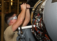 A maintainer fixes an engine.