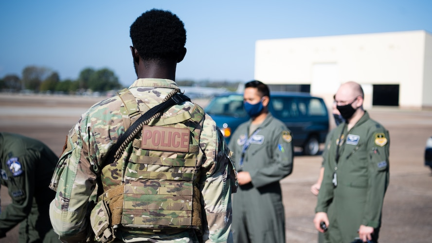 Airman 1st Class Christopher Wimbley, 2nd Security Forces installation entry controller, stands guard at an entry control point during Global Thunder 21 at Barksdale Air Force Base, La., Oct. 22, 2020.