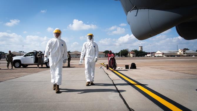 Airman 1st Class William Archer and Staff Sgt. Jeremy Caraan, 96th Aircraft Maintenance Unit crew chiefs prepare to disinfect a B-52H Stratofortress during Global Thunder 21 at Barksdale Air Force Base, La., Oct. 22, 2020.