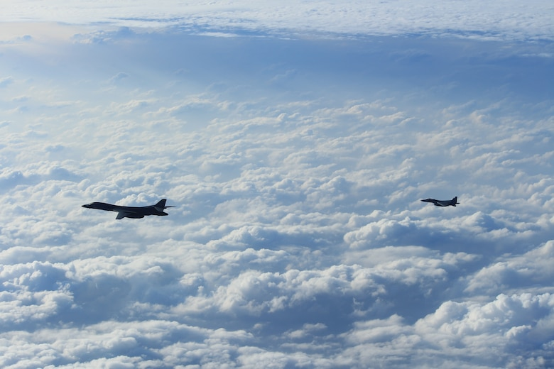 A B-1B Lancer, assigned to the 9th Expeditionary Bomb Squadron, Dyess Air Force Base, Texas, conducts training with a Koku-Jieitai (Japan Air Self Defense Force) F-15 fighter in the vicinity of the Sea of Japan, October 20, 2020.