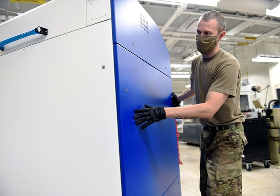 Texas National Guard Staff Sgt. Joshua Turner, 149th Maintenance Squadron aircraft metals technician, moves a newly delivered 3D printer into place at his unit's shop Aug. 12, 2020, at Joint Base San Antonio-Lackland, Texas.