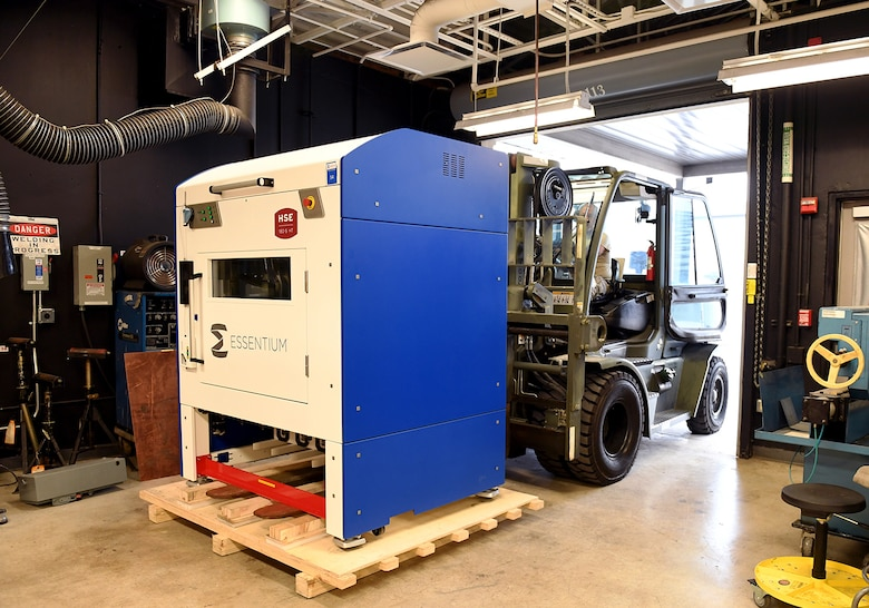 Texas National Guard Master Sgt. Carlos Gil, 149th Maintenance Squadron aircraft metals technician, uses a forklift to move a newly delivered 3D printer Aug. 12, 2020, at Joint Base San Antonio-Lackland, Texas.