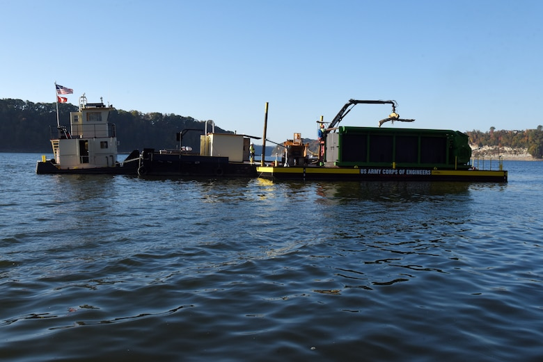 The crew of the PRIDE of the Cumberland places debris into an air curtain burner on a new floating barge Oct. 21, 2020 in Lake Cumberland near Waitsboro Recreation Area in Somerset, Kentucky. (USACE Photo by Lee Roberts)